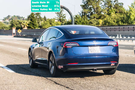 July 26, 2020 Walnut Creek / CA / USA - Tesla Model 3 travelling on the freeway in Silicon Valley; East San Francisco bay area