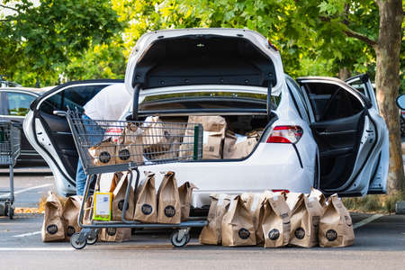 August 1, 2020 Cupertino / CA / USA - Vehicle loaded by an Amazon Prime delivery person with groceries ordered online from Whole Foods Market; The coronavirus pandemic has led to a surge in deliveries 新闻类图片