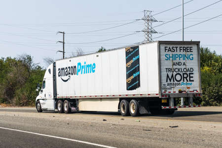 August 1, 2020 Fremont/ CA / USA - Amazon truck driving on the freeway, the large Amazon Prime Smile logo printed on the side
