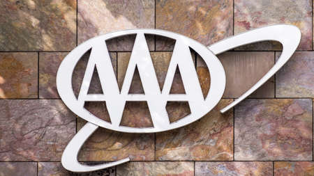 Jul 30, 2020 Menlo Park / CA / USA - AAA logo at one of their offices in San Francisco Bay Area; The American Automobile Association (AAA – or