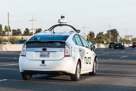 July 25, 2020 Fremont / CA / USA - Nuro autonomous vehicle driving on the freeway in Silicon Valley; Nuro is a robotics company founded by two ex Waymo (Google self driving car project) engineers 新闻类图片