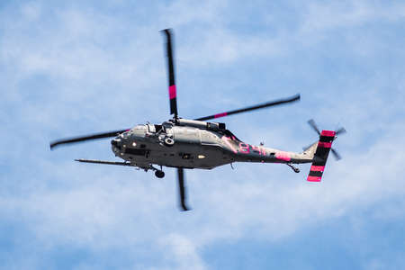 August 13, 2020 Mountain View / CA / USA -  Military helicopter with pink markings in mid flight; California National Guard HH-60 Black Hawks bare a different color when called upon to fight wildfires