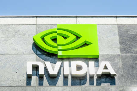 August 9, 2019 Santa Clara / CA / USA - The NVIDIA logo and symbol displayed on the facade of one of their office buildings located in the Company's campus in Silicon Valley 報道画像