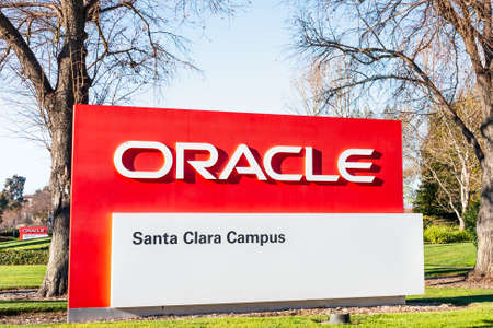 February 7, 2020 Santa Clara / CA / USA - Oracle logo at their campus in Silicon Valley; Oracle Corporation is a global computer technology company specializing in database management systems 報道画像