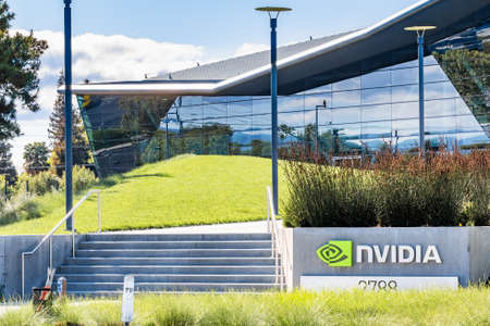 March 30, 2020 Santa Clara / CA / USA - Entrance to Nvidia Endeavor office building at the Company's corporate Headquarters in Silicon Valley; the NVIDIA logo displayed on the right