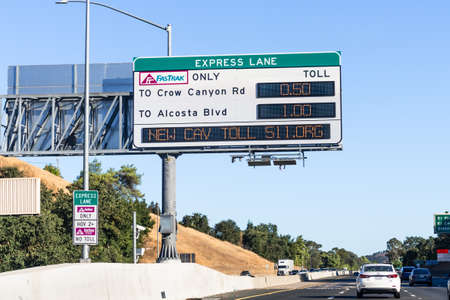 Sep 23, 2020 San Ramon / CA / USA - Freeway Express Lane sign displaying the next exits and the applicable fees, plus a message about the new CAV (Clean Air Vehicle) toll; East San Francisco Bay Area