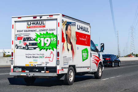 September 23, 2020 Fremont / CA / USA - U-Haul van travelling on the freeway; U-Haul is an American company offering DIY moving solutions