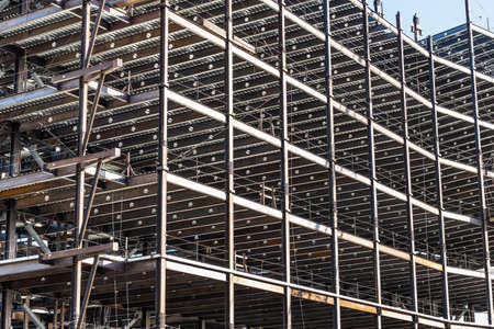 Detail of multilevel modern office building under construction with visible steel frame, Silicon Valley, California 免版税图像