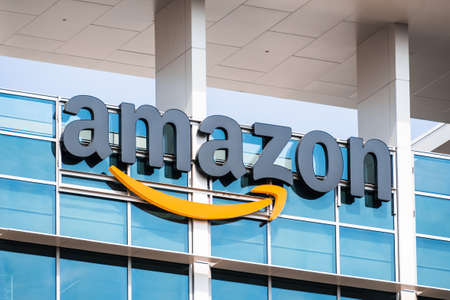 Oct 8, 2020 Sunnyvale / CA / USA - Amazon logo on the facade of one of their office buildings located in Silicon Valley, San Francisco bay area