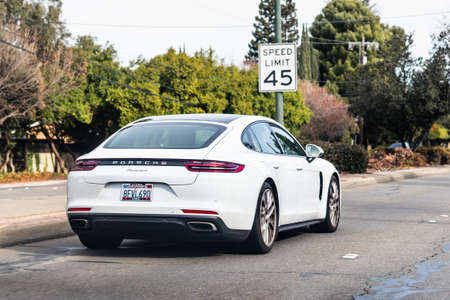 Jan 1, 2021 Concord / CA / USA - Porsche Panamera vehicle driving on a city street; The Porsche Panamera is a mid/full-sized luxury vehicle manufactured by the German automobile manufacturer Porsche