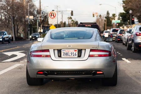 Jan 15, 2021 Concord / CA / USA - Rear view of Aston Martin DB9 waiting at a traffic light in East San Francisco Bay Area Editorial