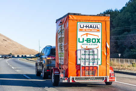 Nov 27, 2020 Concord / CA / USA - Semi truck towing an U-Haul cargo box trailer, on a freeway in San Francisco bay area; U-Haul is an American moving equipment and storage rental company Editorial