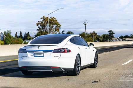 Oct 10, 2020 Concord / CA / USA - Tesla Model S travelling on the freeway in Silicon Valley; East San Francisco bay area Editorial