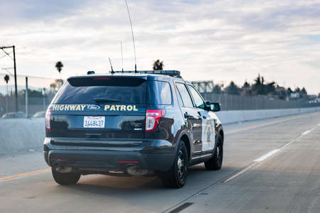 Jan 15, 2021 Pittsburg / CA / USA - Police car driving on the freeway in East San Francisco bay area
