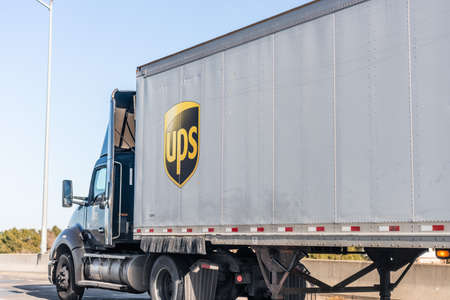 Jan 5, 2021 Concord / CA / USA - UPS (United Parcel Service) truck driving on the freeway in East San Francisco Bay area