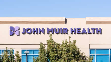 Nov 4, 2020 Brentwood / CA / USA - John Muir Health on the facade of the Urgent Care Center in East San Francisco Bay Area, John Muir Health is a hospital network serving Contra Costa County Editorial