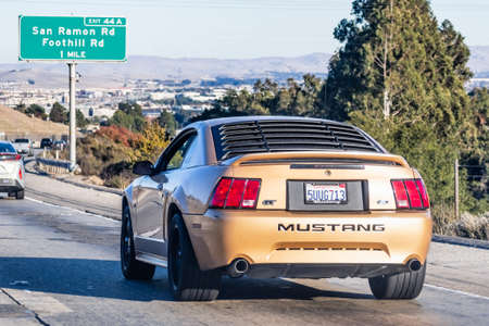 Nov 27, 2020 San Ramon / CA / USA - Ford Mustang GT old model, driving on the freeway in San Francisco Bay Area