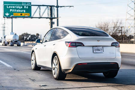 Jan 15, 2021 Pittsburg / CA / USA - Tesla Model Y travelling on the freeway in East San Francisco bay area