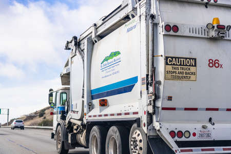 Jan 5, 2021 Antioch  / CA / USA - Mt Diablo Resource Recovery (MDRR) vehicle driving on the highway; MDRR is providing garbage hauling and recycling services to part of Contra Costa County