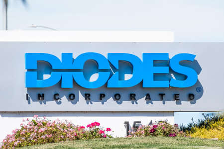 Sep 24, 2020 Milpitas / CA / USA - Diodes logo at their headquarters in Silicon Valley; Diodes Inc is an American manufacturer and supplier of discrete, logic, analog and mixed-signal semiconductors Editorial