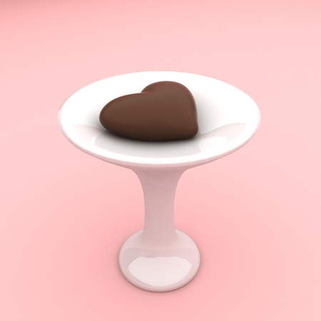 Chocolate candy in a heart shape on a ceramic stand
