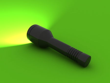 defuse: Black flashlight on a green background Stock Photo