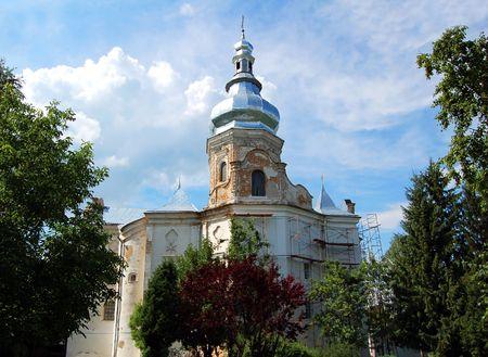 Antique stone baroque bell tower in Ukraine photo