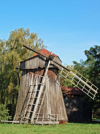 ethnographic: Antique wooden windmill at ethnographic museum, Pereiaslav- Khmelnytskyi, Ukraine Stock Photo