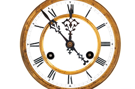 Antique vintage clock, isolated on white background photo
