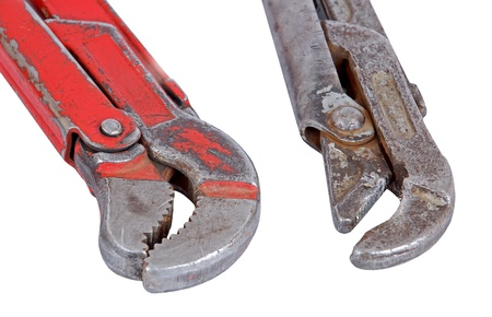 Old rusty adjustable gas wrench, isolated on white background photo