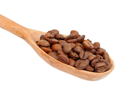 Coffee beans in wooden spoon, isolated on a white background photo