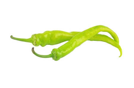 hot peppers: Green cayenne chili pepper, isolated on white background
