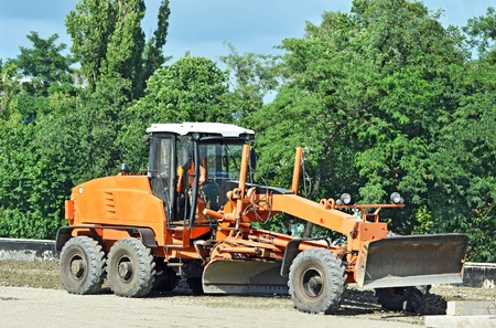 tractor warning: Orange bulldozer on bridge road construction site Stock Photo