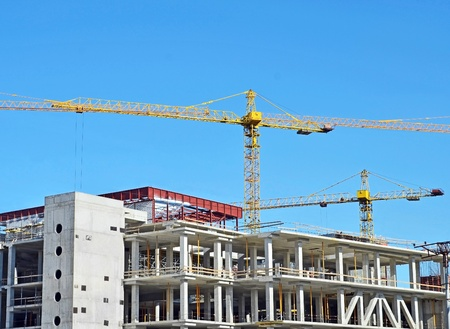 Crane and building construction site against blue sky Stock Photo - 10577204
