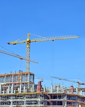 Crane and building construction site against blue sky Stock Photo - 10589411