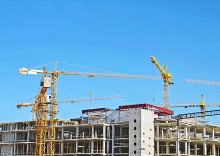 Crane and building construction site against blue sky Stock Photo - 10680782