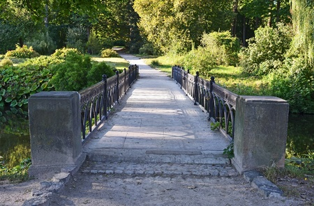 Old vintage park bridge in Alexandria, Ukraine photo