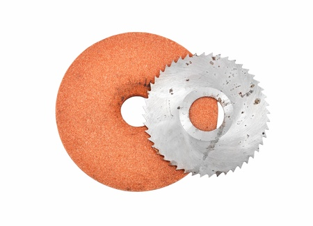 Grinding disc and circular saw blade, isolated on white background photo