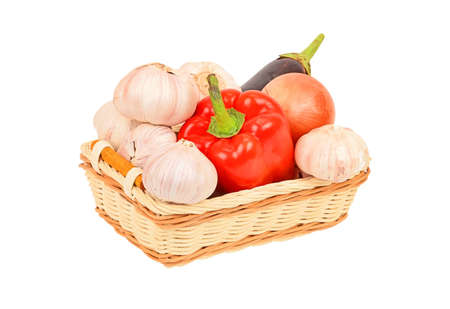 Vegetables in a wattled basket, isolated on white background photo