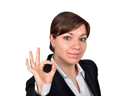 Happy smiling cheerful young business woman showing okay gesture, isolated on white background  photo