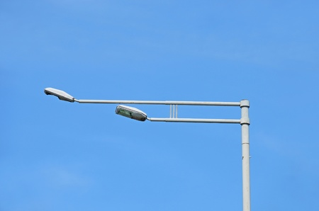 Street light against a blue sky background photo