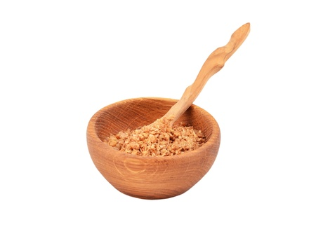 Buckwheat flocks in a wooden bowl, isolated on white background Stock Photo - 13773537