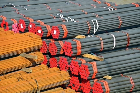 Stacked PVC and steel pipe ready for shipment Stock Photo - 14059459