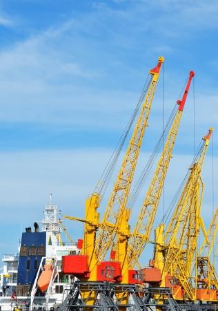Cargo crane and ship in port Odessa, Ukraine Stock Photo