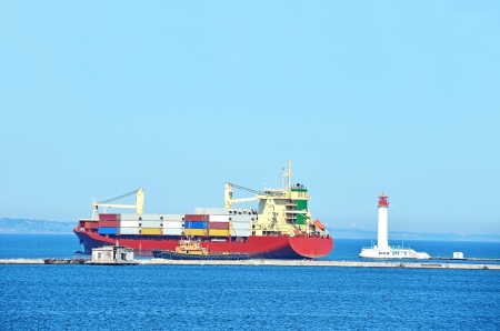 Cargo ship near lighthouse in Odessa, Ukraine photo