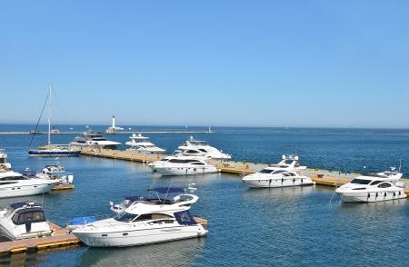 White motor yacht over harbor pier, Odessa, Ukraine photo