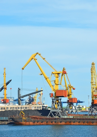 Cargo crane, ship, freight traine and coal in port photo