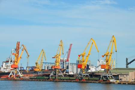 Cargo crane freight traine and coal in port photo