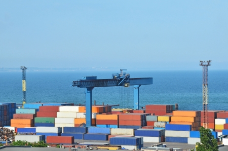 bight: Port cargo crane and container over blue sky background