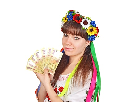 Ukrainian woman worker with national money hryvna in embroidery costume Stock Photo